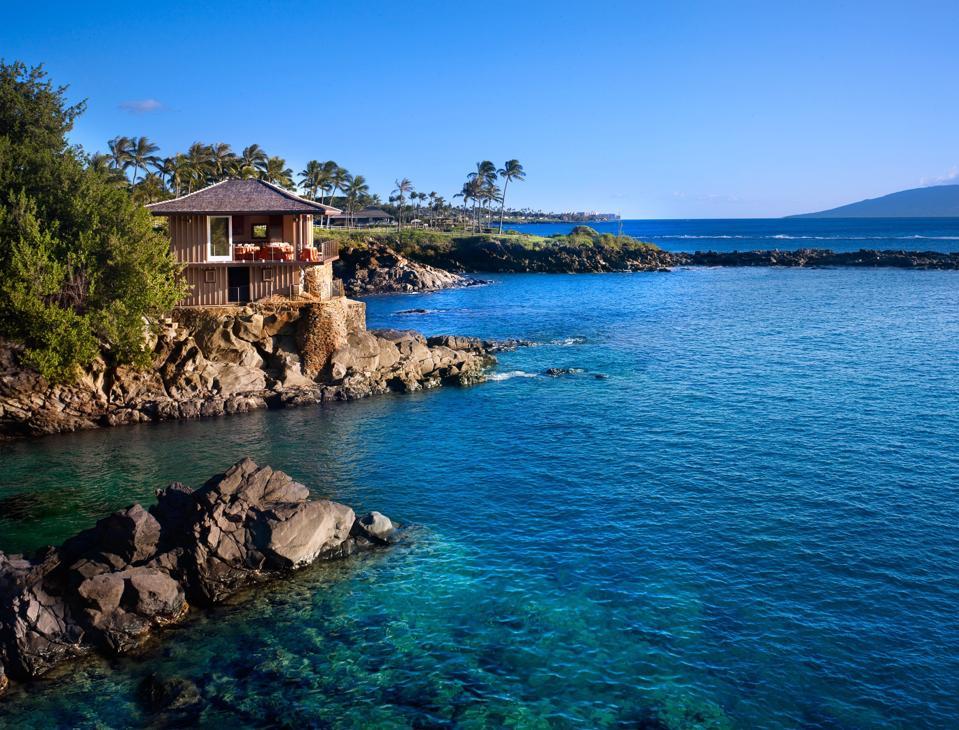 An exterior photo of Montage Kapalua Bay resort in Hawaii.
