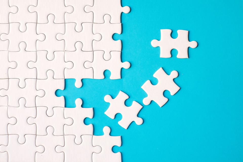 Directly Above Shot Of Jigsaw Puzzle On Blue Background