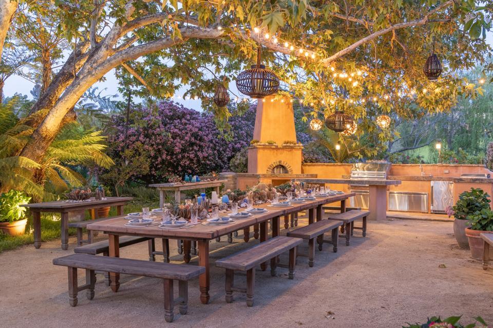 patio dining room outdoor kitchen at villa nafissa in rancho santa fe san diego