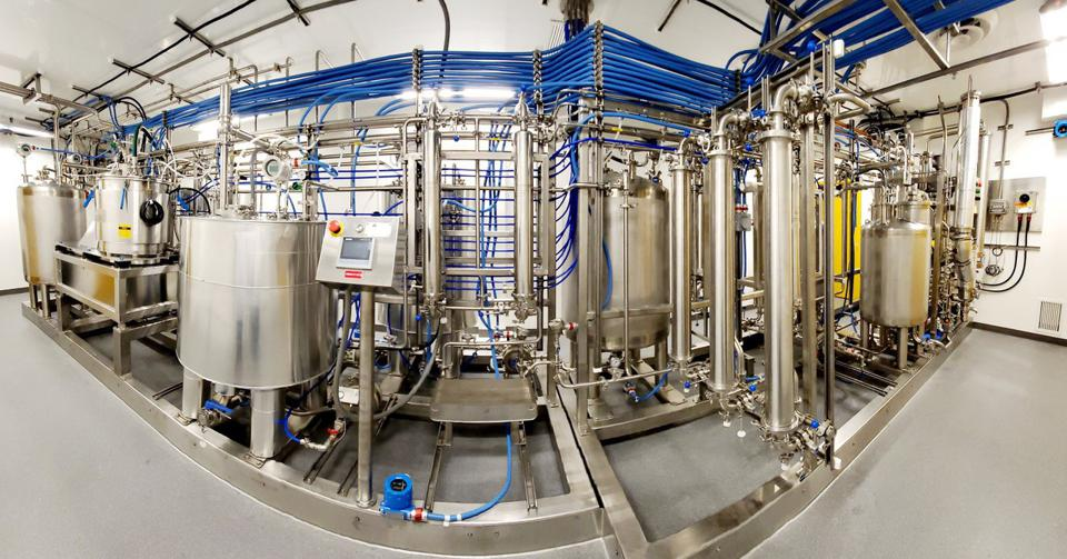 Wide-angle shot of the machinery required to convert dry cannabis into oil from Nextleaf