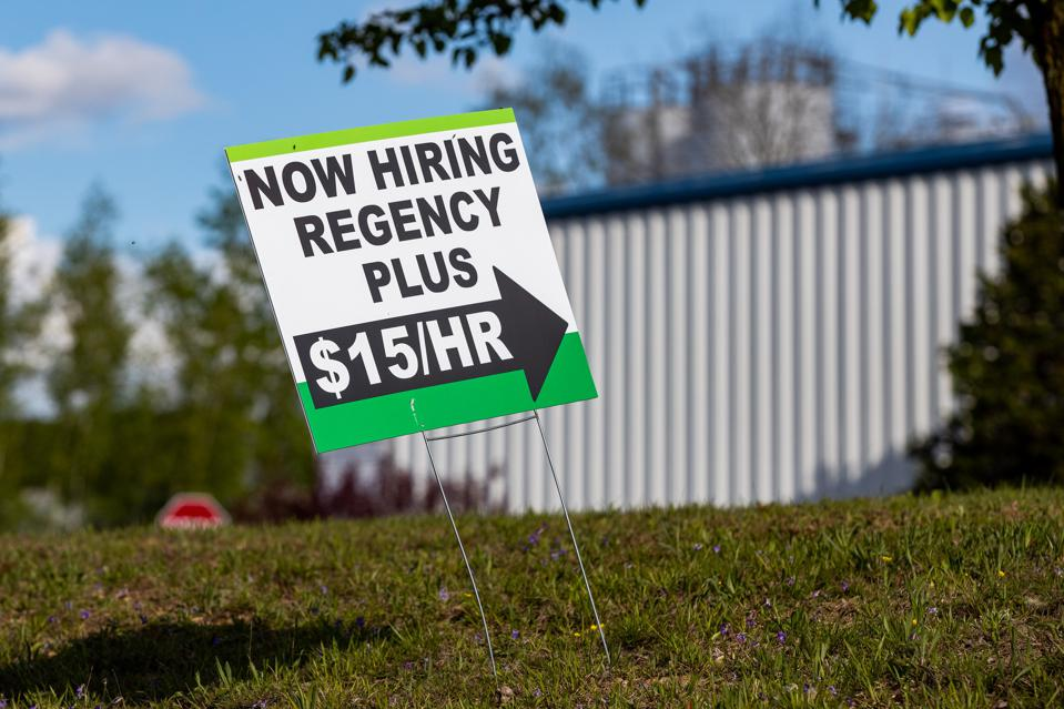 Some employers are raising wages to attract workers as the economy rebounds