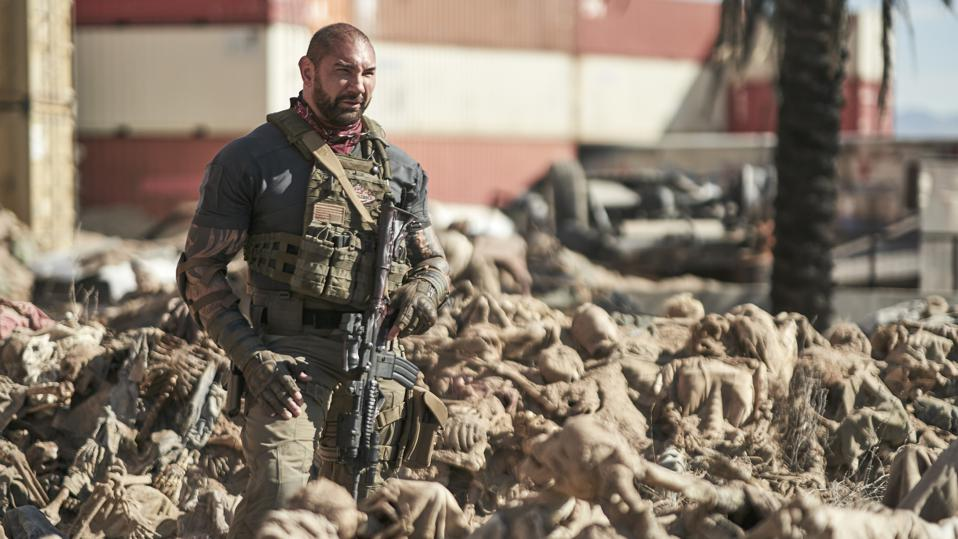Dave Bautista stands amongst a pile of dead bodies in Army of the Dead
