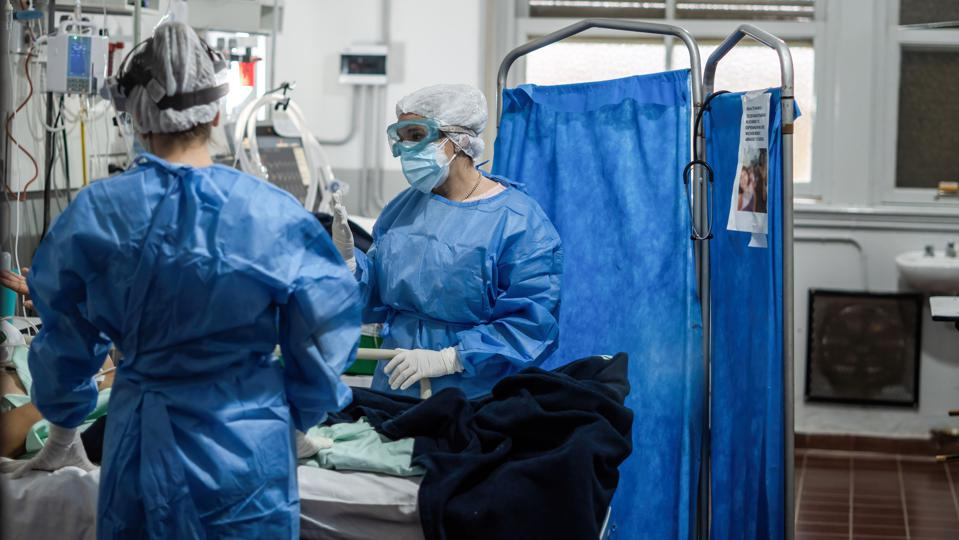 Nurses wearing Personal Protective Equipment suites (PPE)...