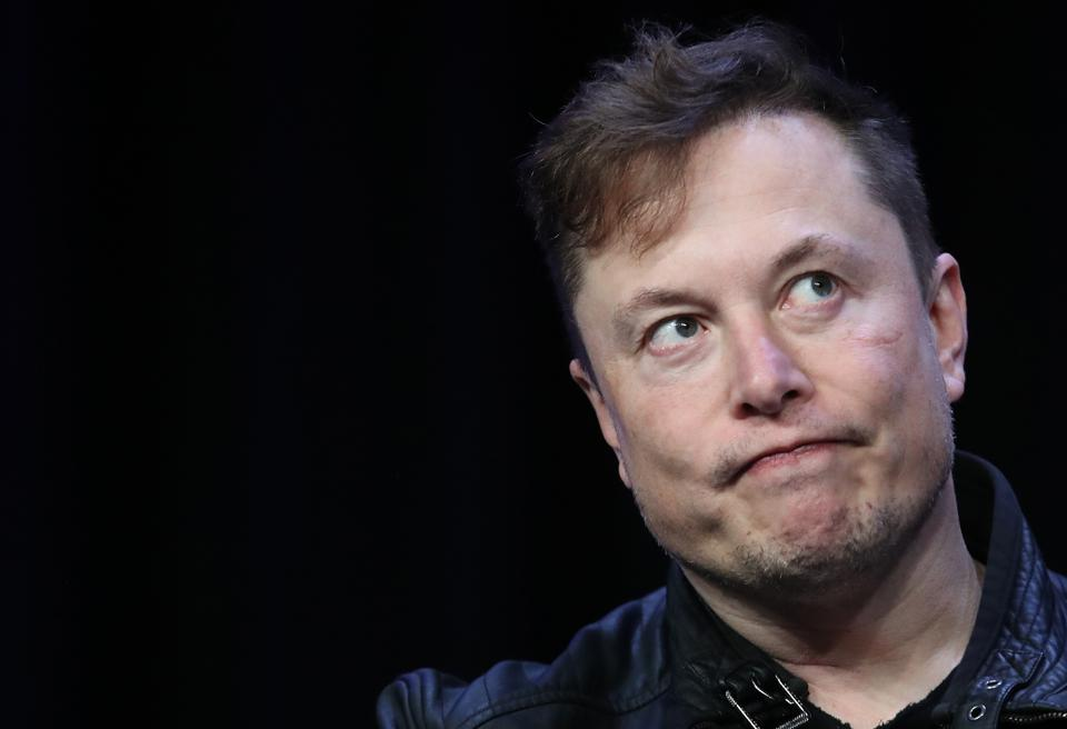 Elon Musk looks perplexed, but did Anonymous just threaten him over viral Bitcoin tweets?