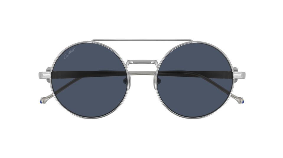 Pasha de Cartier sunglasses in smooth platinum-finish titanium, round shape and blue lenses.