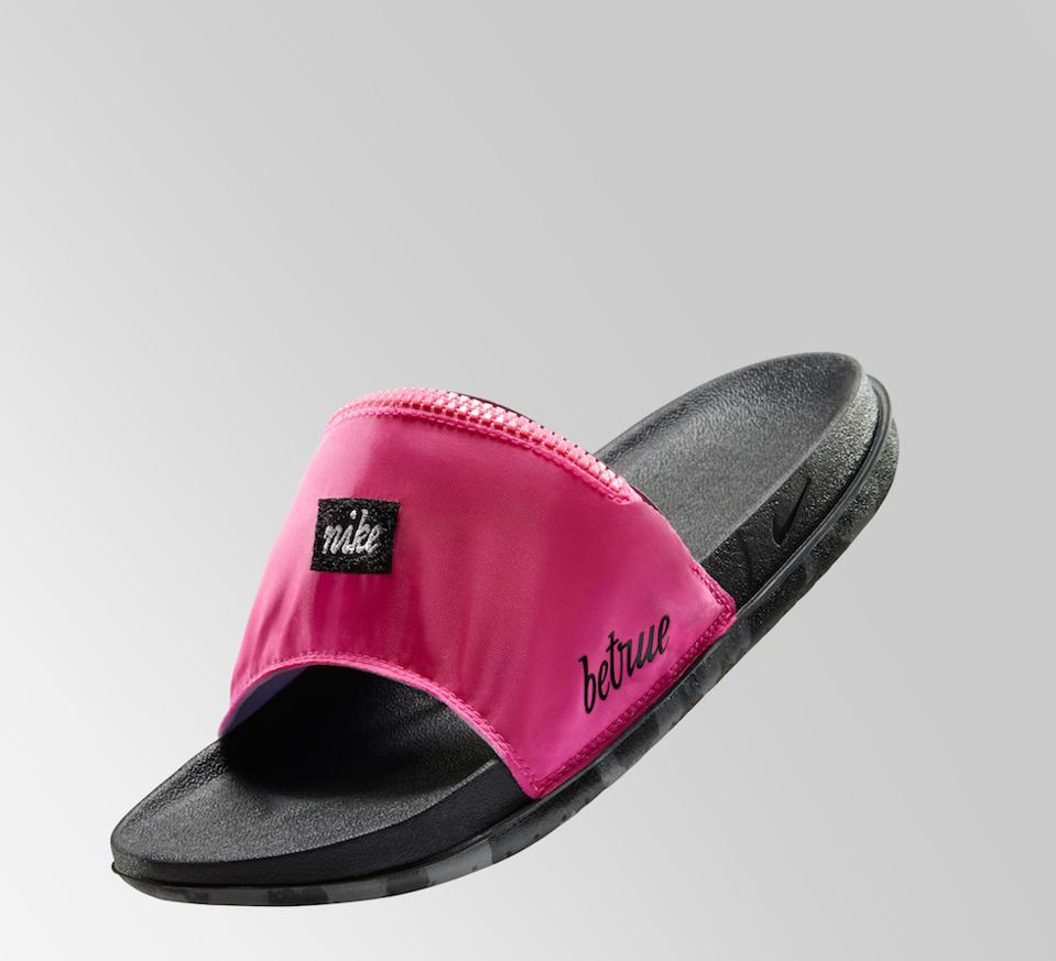 Nike's 2021 Be True All Out Utility Slide is pink and black.