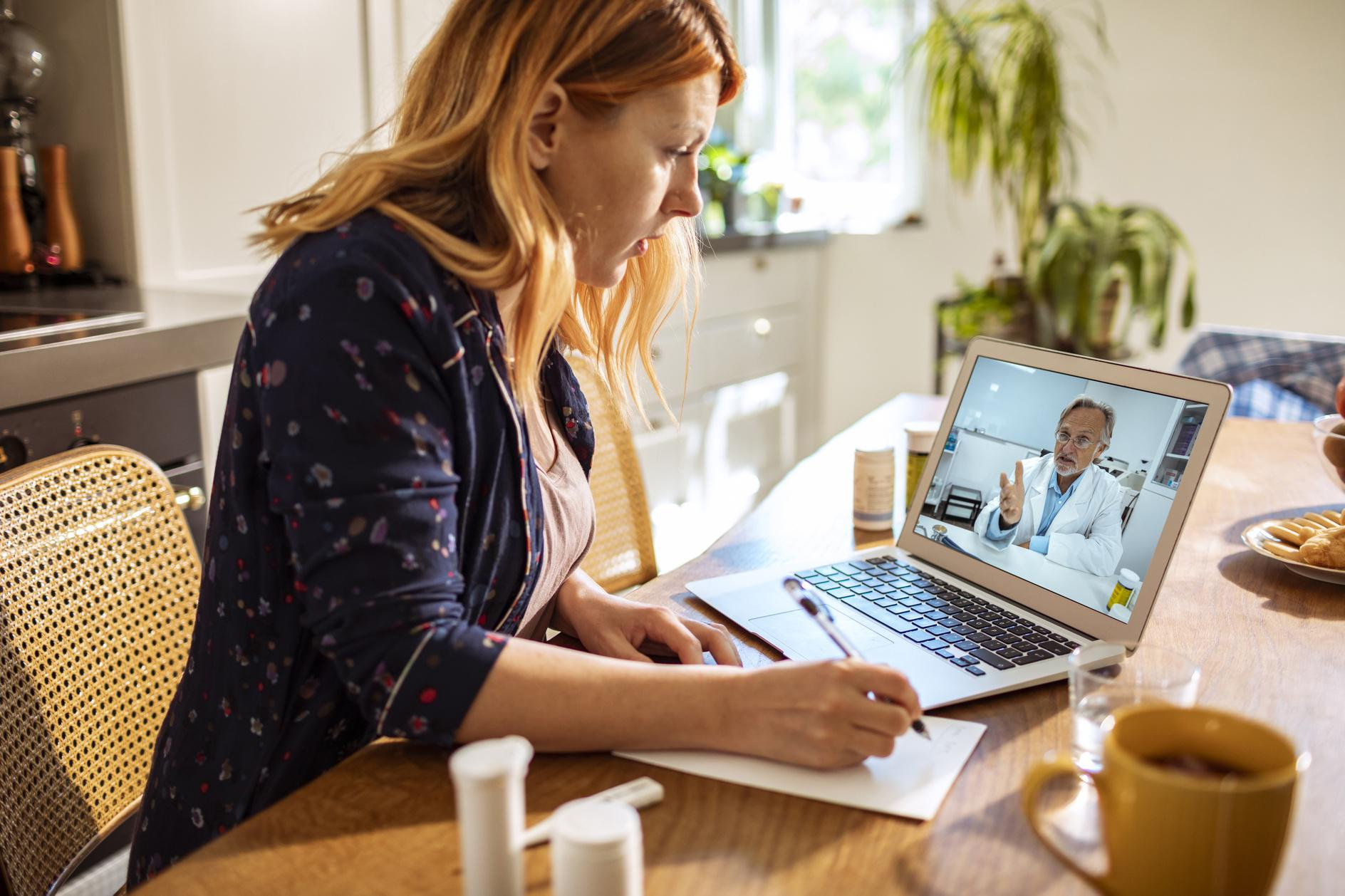 Young woman consulting with her doctor over a video call