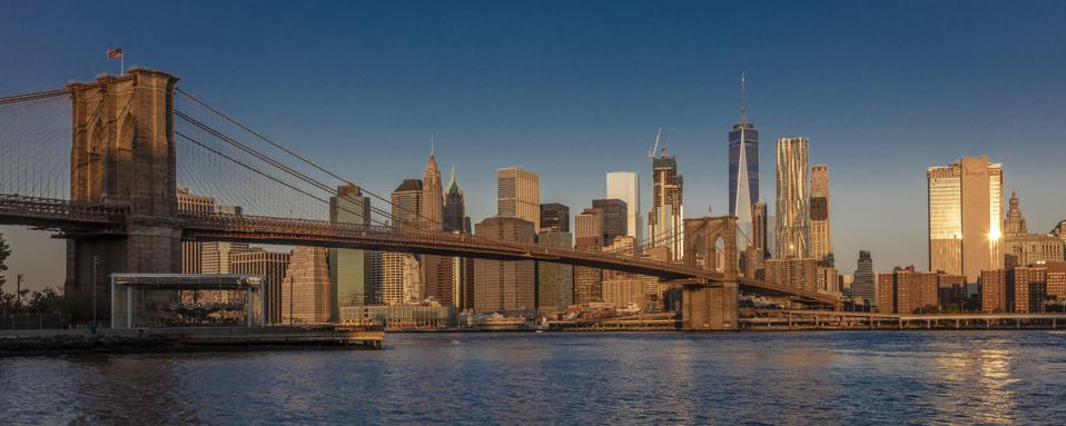 The Brooklyn, Manhattan and Williamsburg bridges all have walkways for pedestrians to get nice and high.