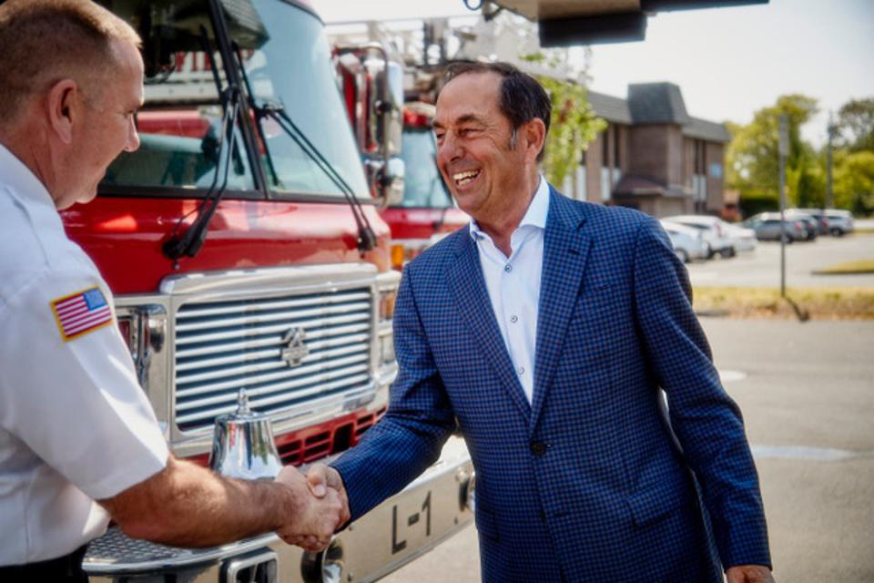 Josh Cellars founder Joe Carr shakes hands with the Springfield MA fire chief.