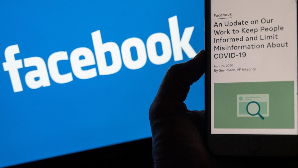A smart phone screen showing a new Facebook policy on Covid-19 misinformation