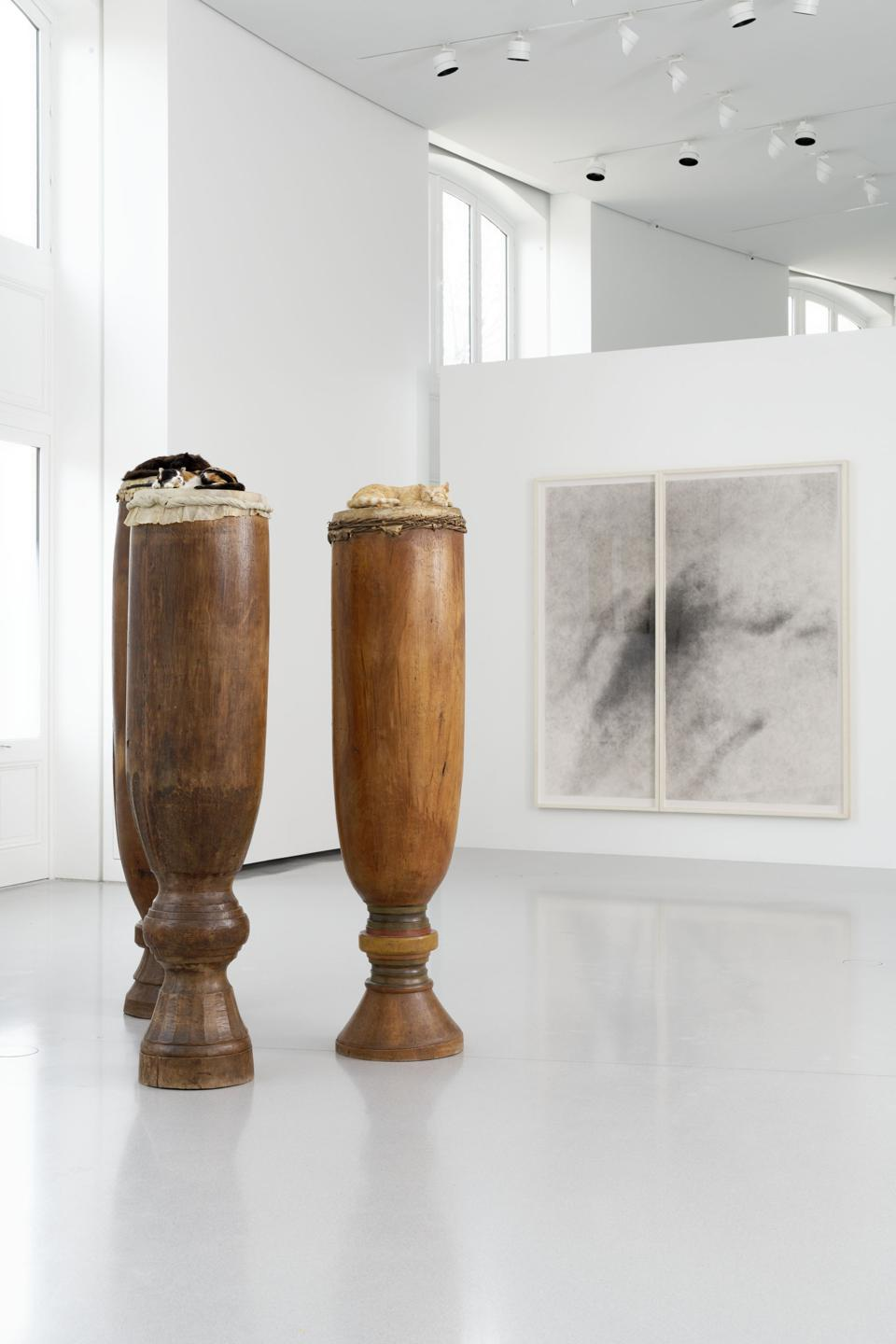 David Hammons, High Level of Cats, 1998, 3 drums, 3 taxidermed cats, and Basketball Drawing, 2008, charcoal on paper