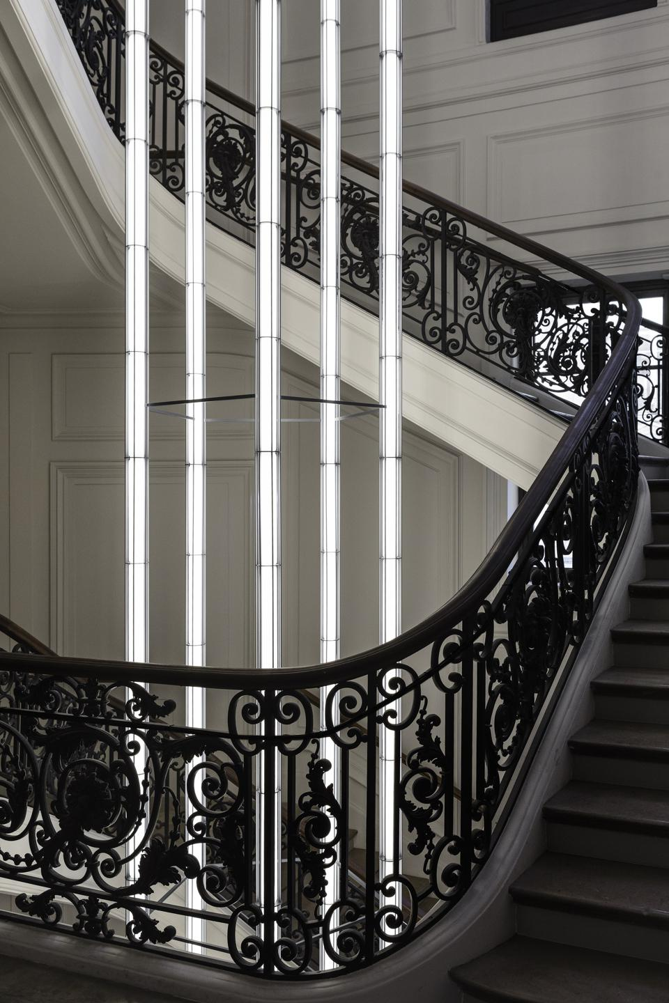 Monumental light in the 19th century staircase designed by Ronan & Erwan Bouroullec