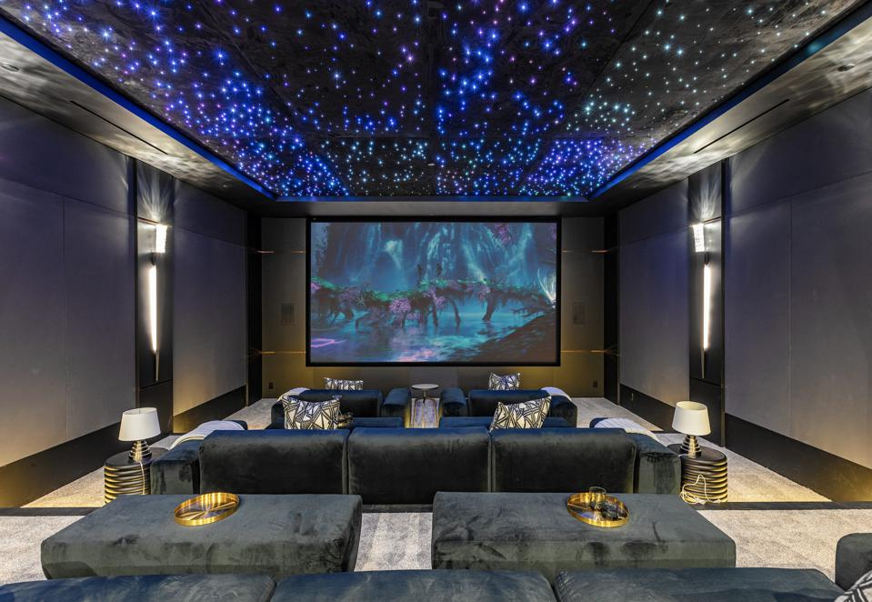 A Rolls-Royce-inspired movie theater with a starlight ceiling.