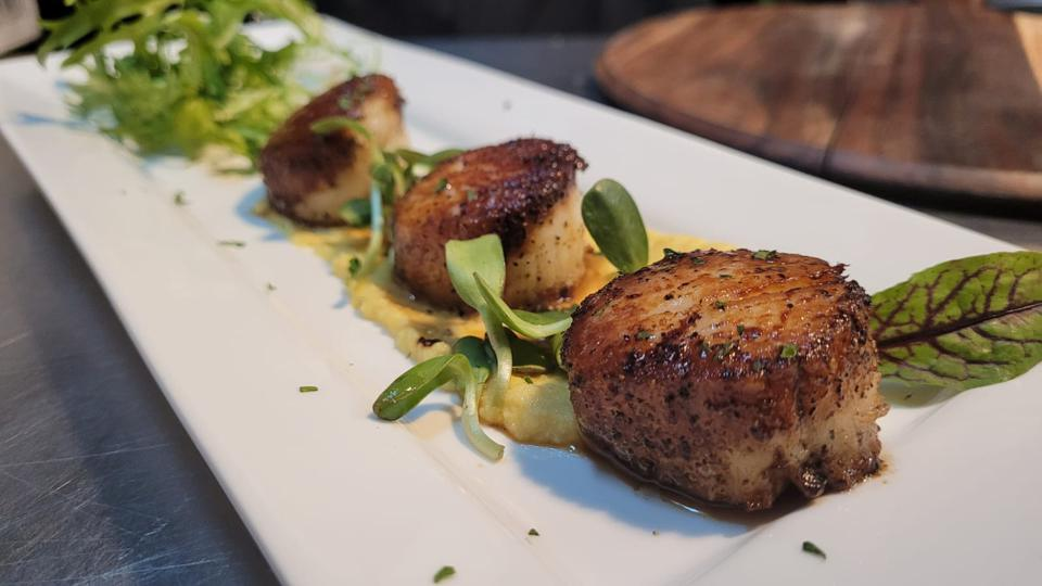 seared jumbo scallops on offer at a new farm-to-table restaurant in upper manhattan