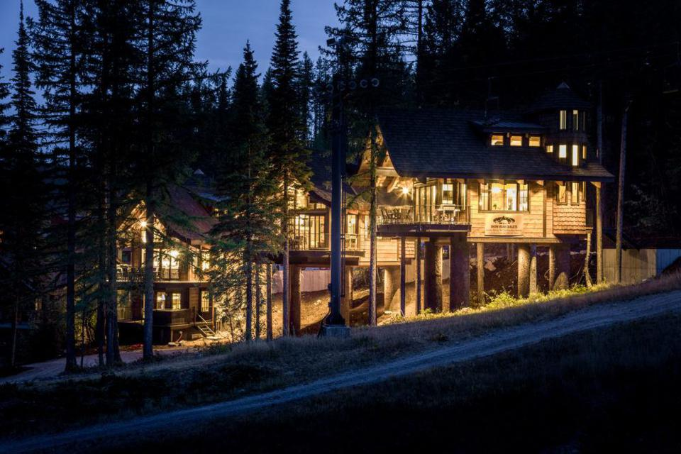 whitefish resort treehouse chalets lights glow at night