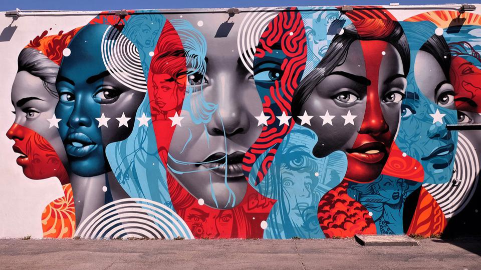 Mural of women's faces in profile