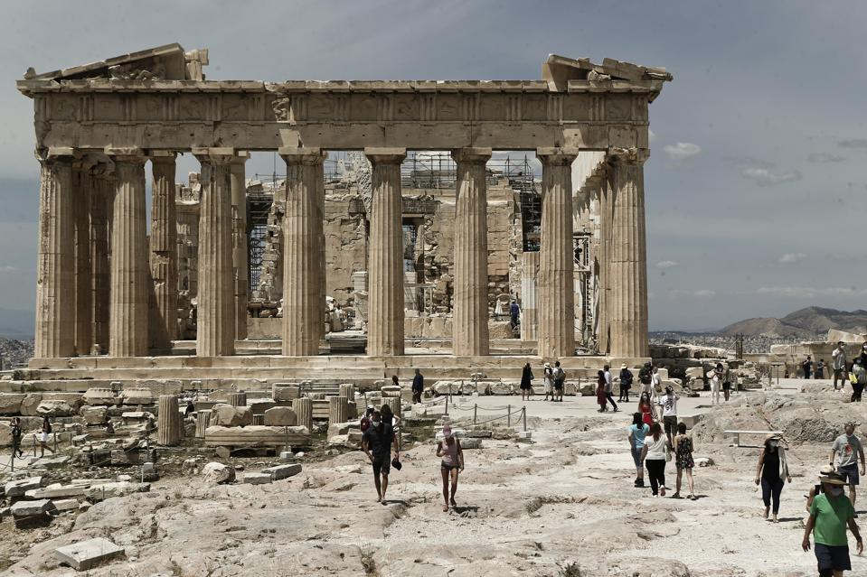 Tourism In Greece: Tourist walk in front the ancient temple of Parthenon