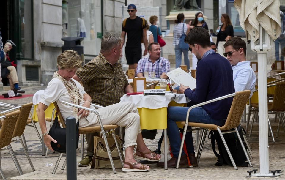 Locals And Tourists back In The Streets In Portugal