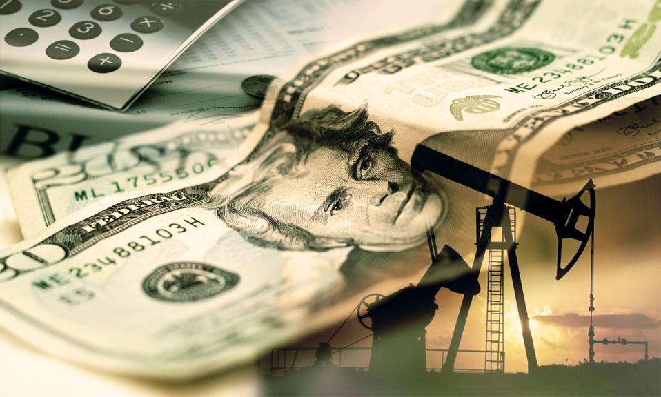Oil pump on background of US dollar, 20 US dollars.