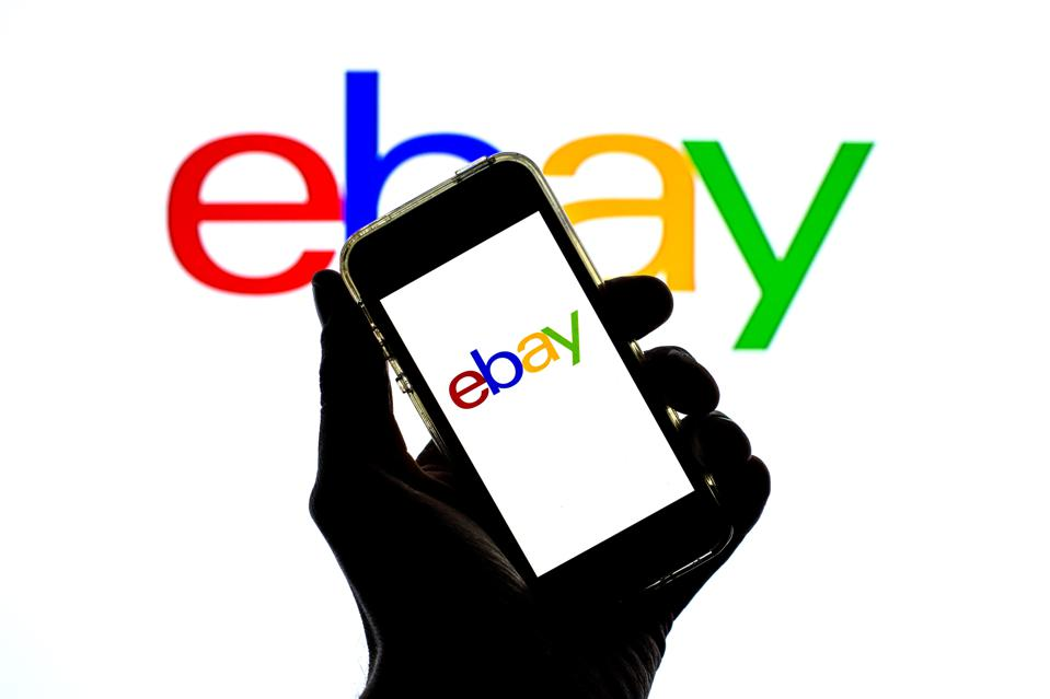 In this photo illustration an EBay app seen displayed on a...