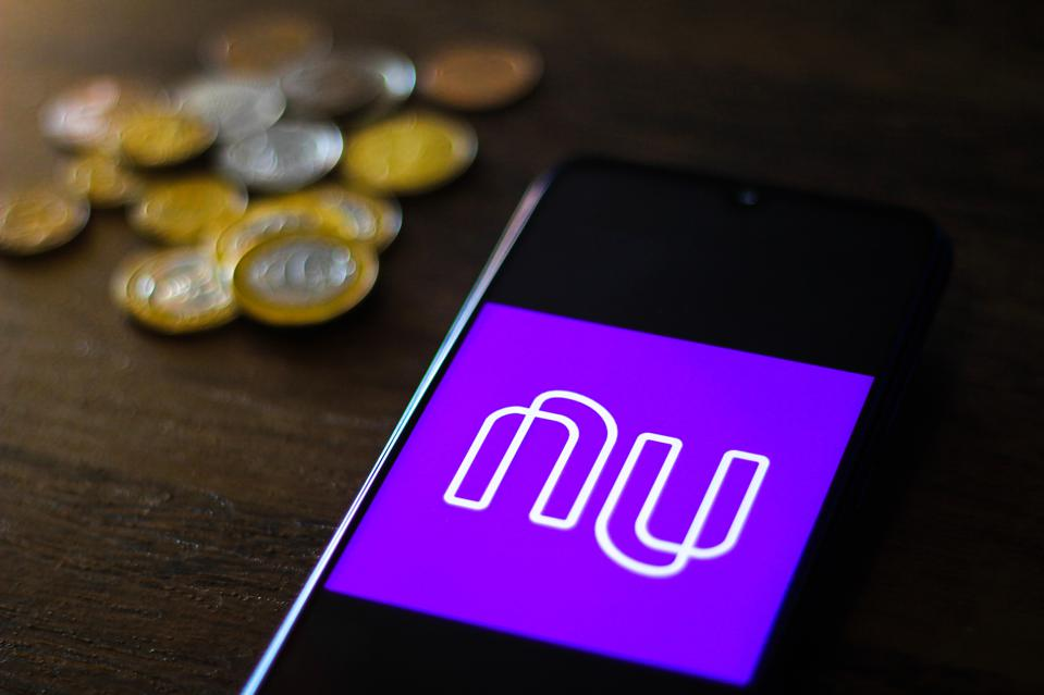 In this photo illustration the Nubank logo is seen displayed...