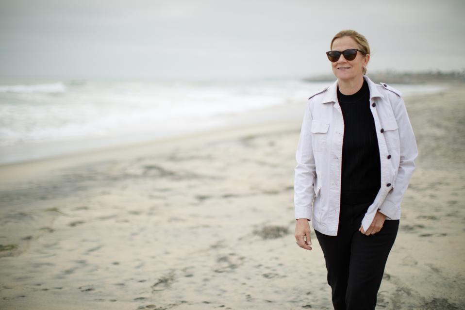 Jill Ellis, walking on a beach.