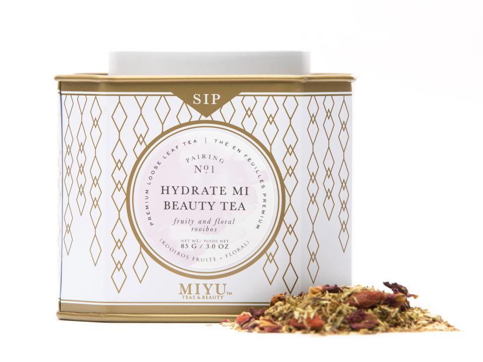 Miyu Hydrate Mi Beauty Tea next to tea leaves.