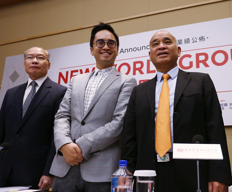 New World Development CEO Adrian Cheng (second left) and his father, New World Development Chairman Henry Cheng (first right).