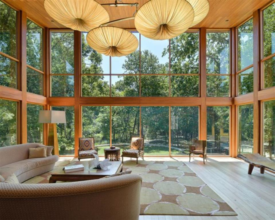 The home captures the wooded lot at every angle