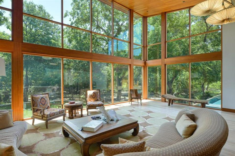 Large room of the teak house with view of nature