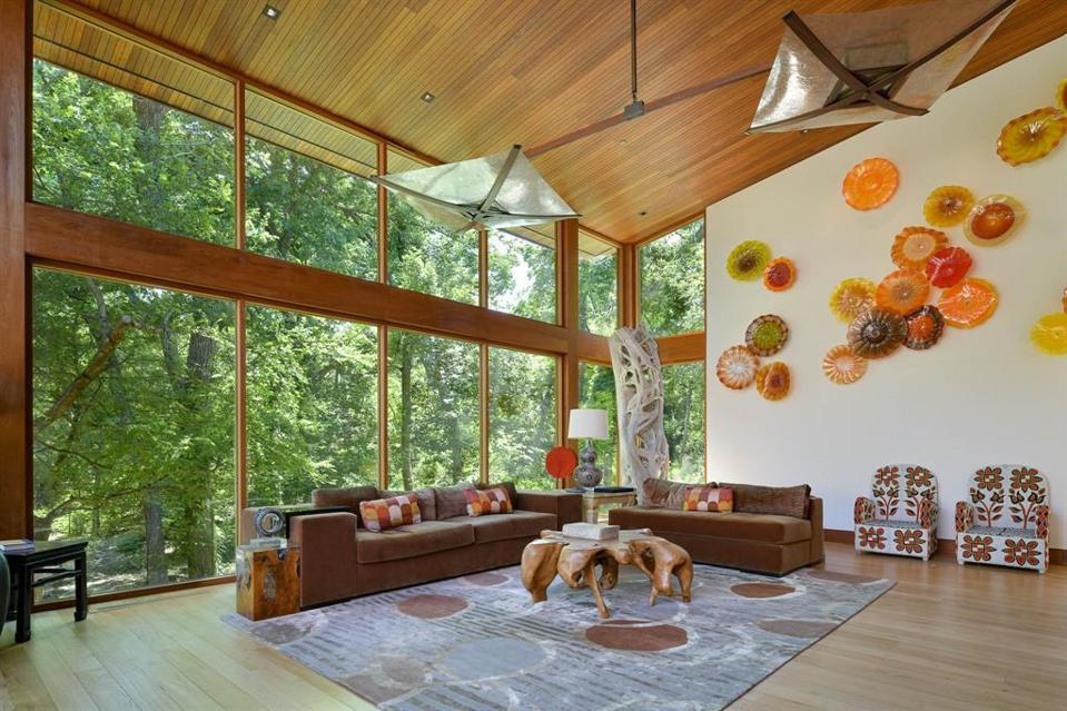 Colored, glass and teak ceilings make this house built in 2010