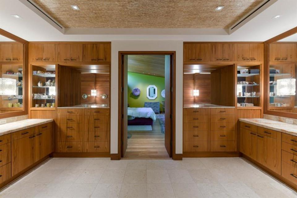 The Master bath storage areas are made of... teak
