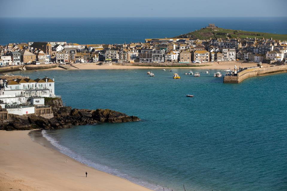 The picturesque Cornish town of St. Ives, complete with sandy beaches and blue water.