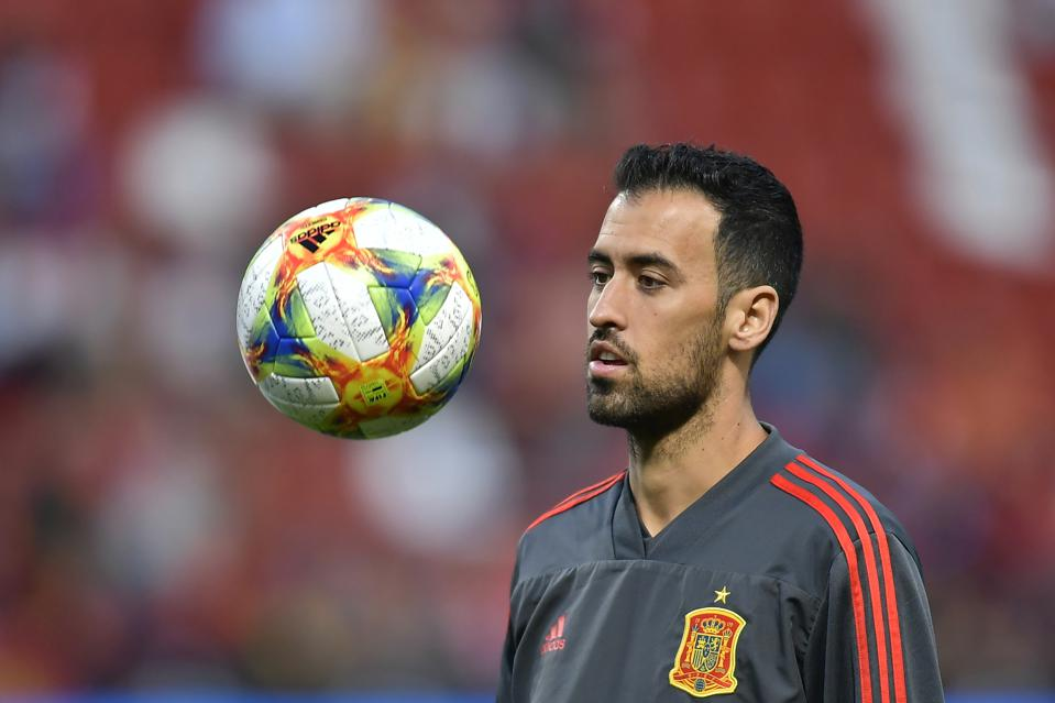 Sergio Busquets practices with a ball during an international match for Spain.