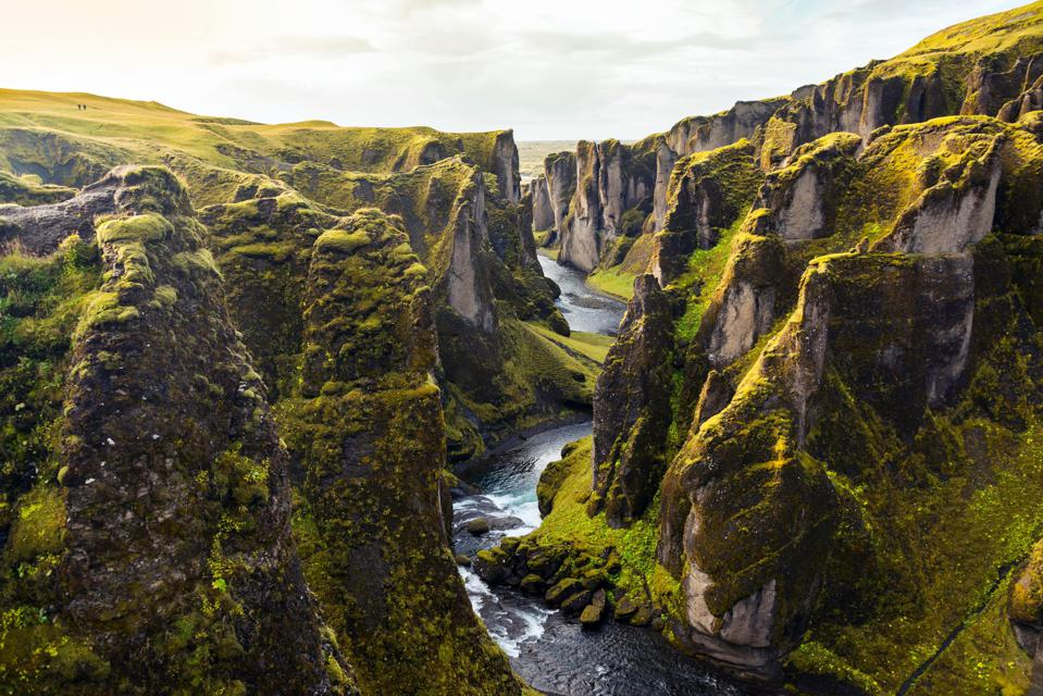 A landscape of mountains and rivers in Iceland.