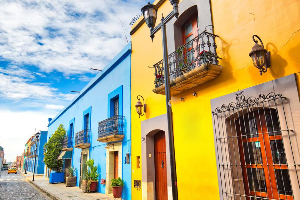 A street with colorful buildings on a travel tour.
