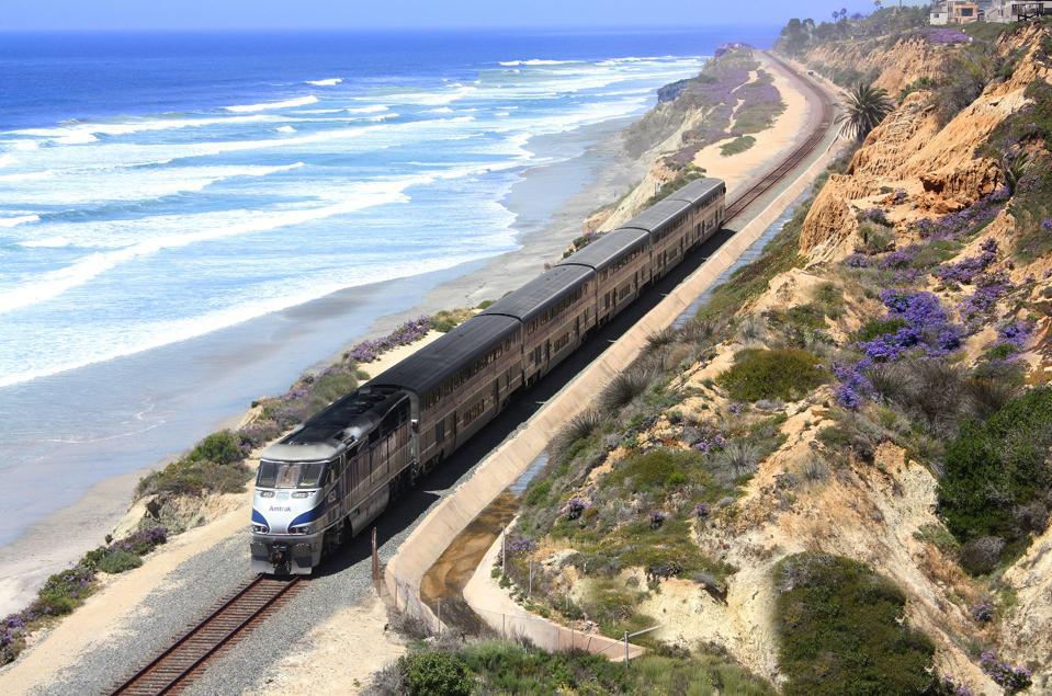 Amtrak's Pacific Surfliner train travels near the Pacific Ocean in California.