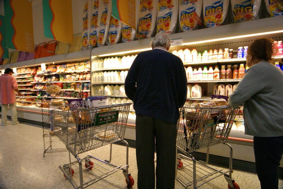Senior Couple, Shopping In A Supermarket