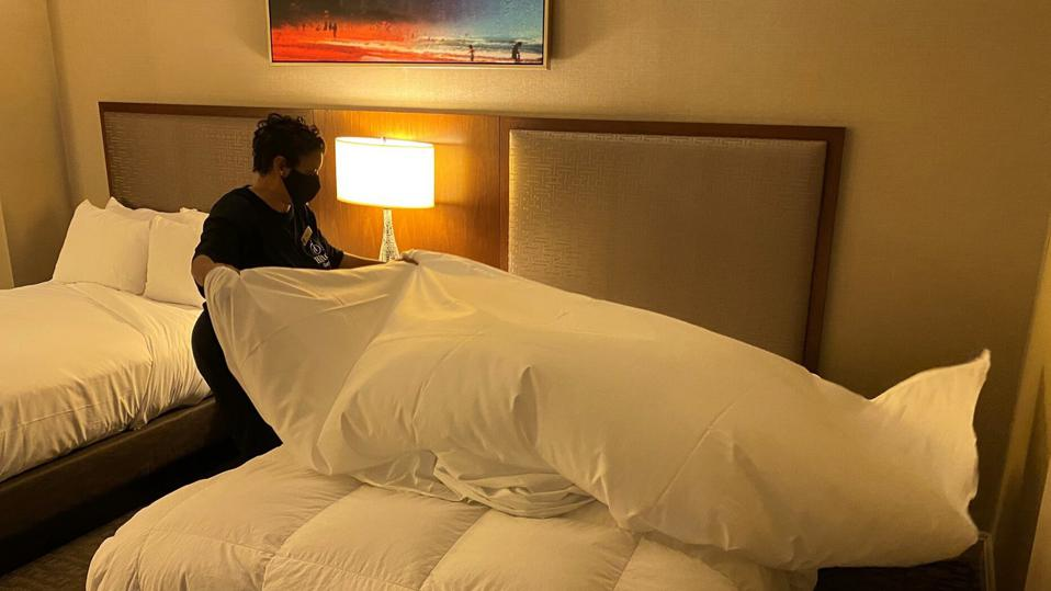woman makes bed