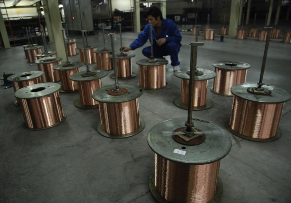 A labourer works at a copper processing factory in Yingtan, Jiangxi province