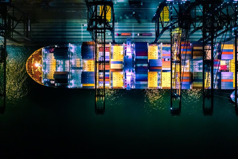 Container ship in import export and business logistic, International transportation, Business logistics concept,Night view, Hong Kong