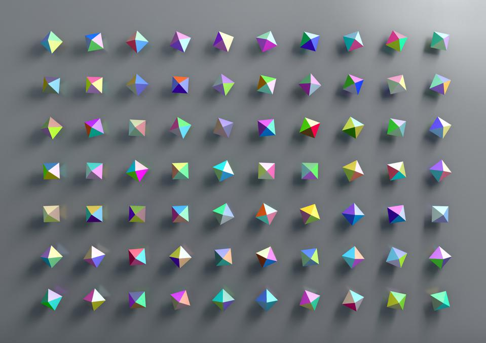 graphic design of multicolored polygonal geometric shapes on gray background