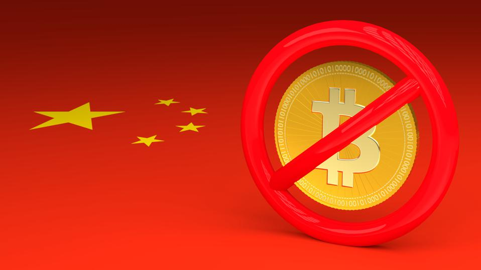 Prohibitive sign with a bitcoin inside on a Chinese flag