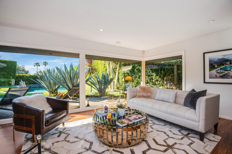 harold b zook studio city midcentury house in the living room with floor to ceiling glass