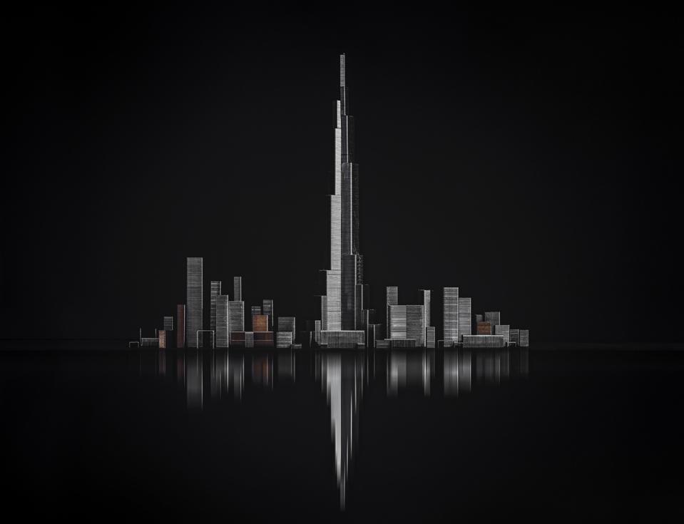 Buildings in Dubai in black background.
