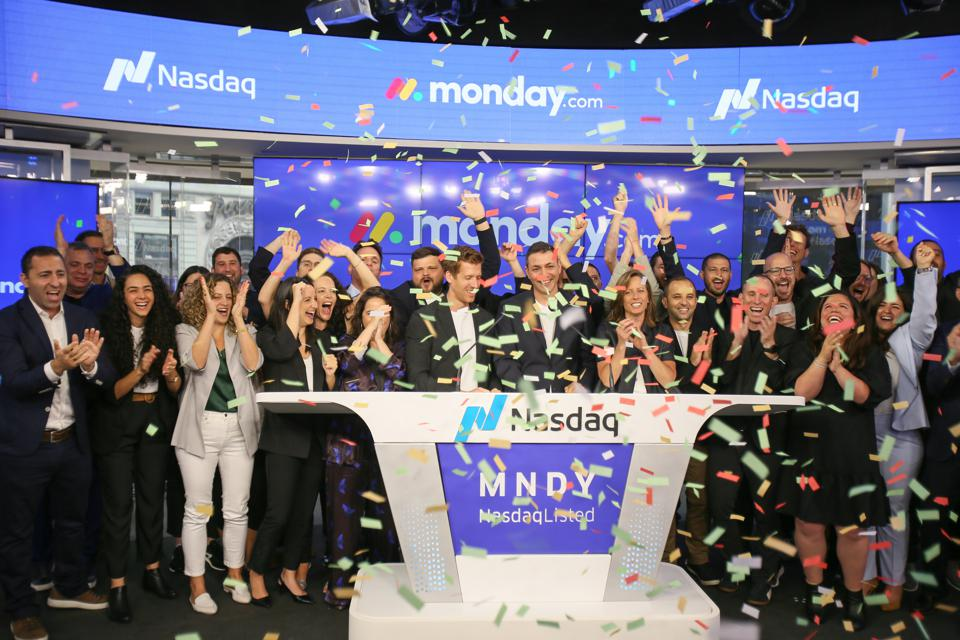Monday.com co-founders Eran Zinman and Roy Mann ring the bell at Nasdaq in June 2021.