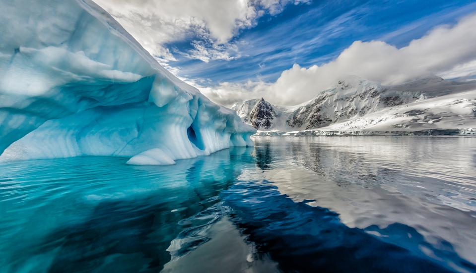 The iceberg is floating in Andord Bay on Graham Land, Antarctica.