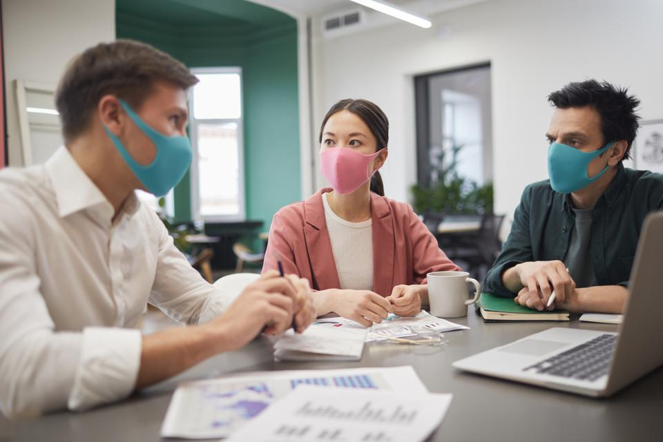 Business people in protective masks