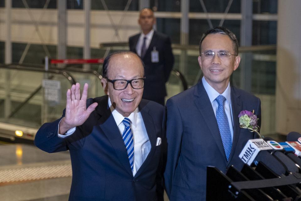 Li Ka-shing (left) and his eldest son's Victor Li (right).