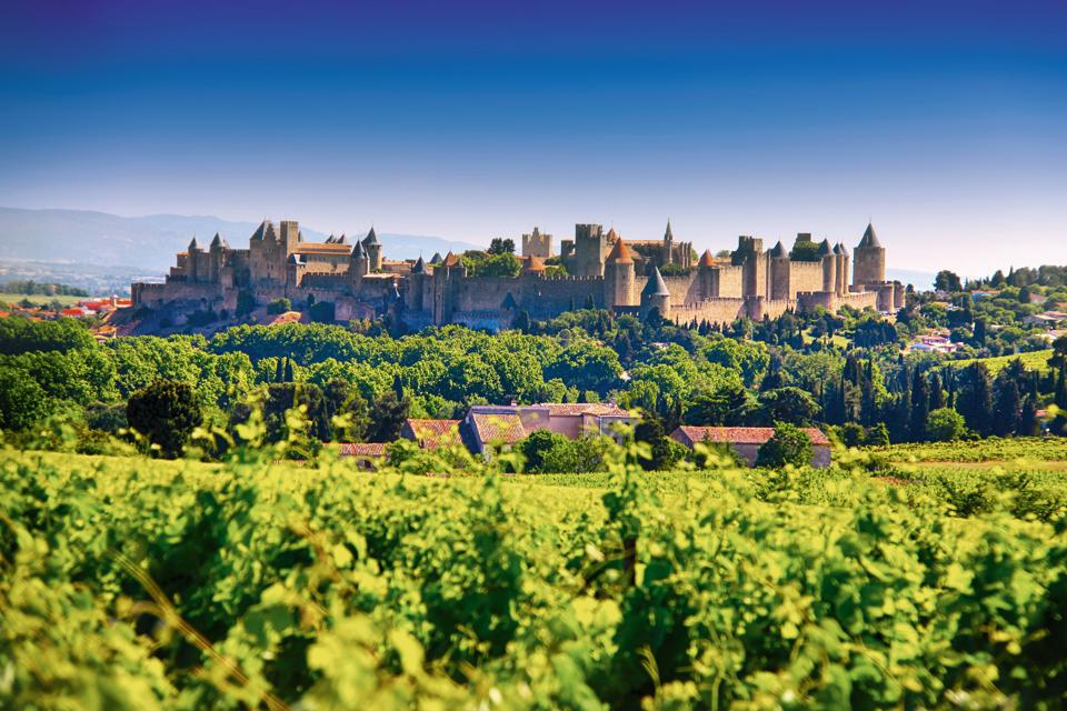The Medieval fortress of Carcassonne and the surrounding vineyards.